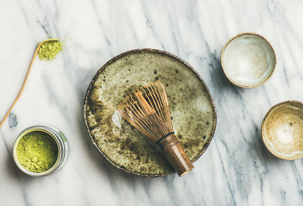 Japanese tools and bowls for brewing matcha tea top view