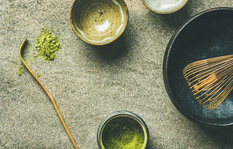 Japanese tools for brewing matcha tea  grey concrete background