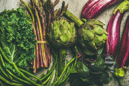 Flat lay of fresh green and purple vegetables clean eating