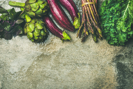 Flat lay of fresh green and purple vegetables  copy space