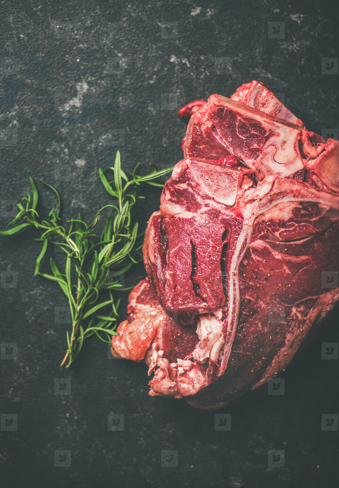 Close up of fresh raw beef meat t bone steaks with rosemary
