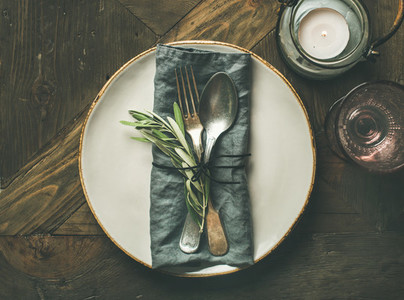 Fall table decoration setting with cutlery and candle