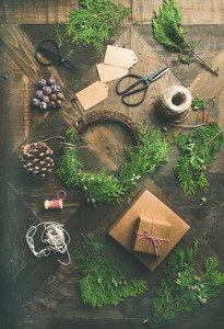 Flat lay of Christmas and New Year decoration over wooden table