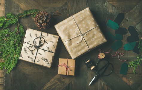 Flat lay of gift boxes  rope  fur branches  scissors  cones  stickers