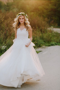 Beautiful model girl in a white wedding dress