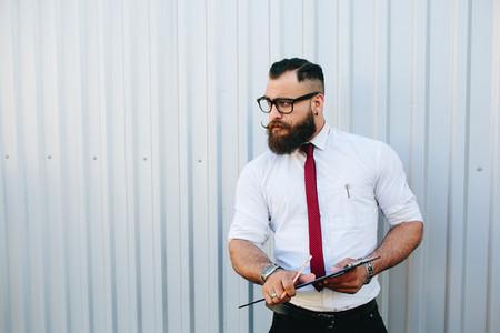businessman against a white wall