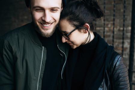 couple posing in backstreet