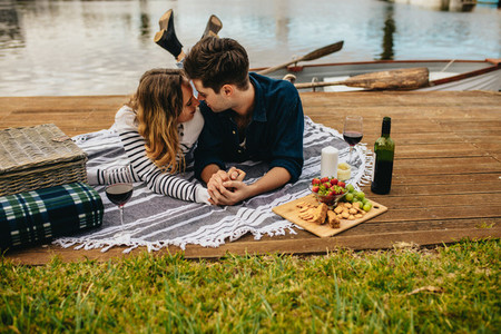 Romantic couple in love on a date near a lake