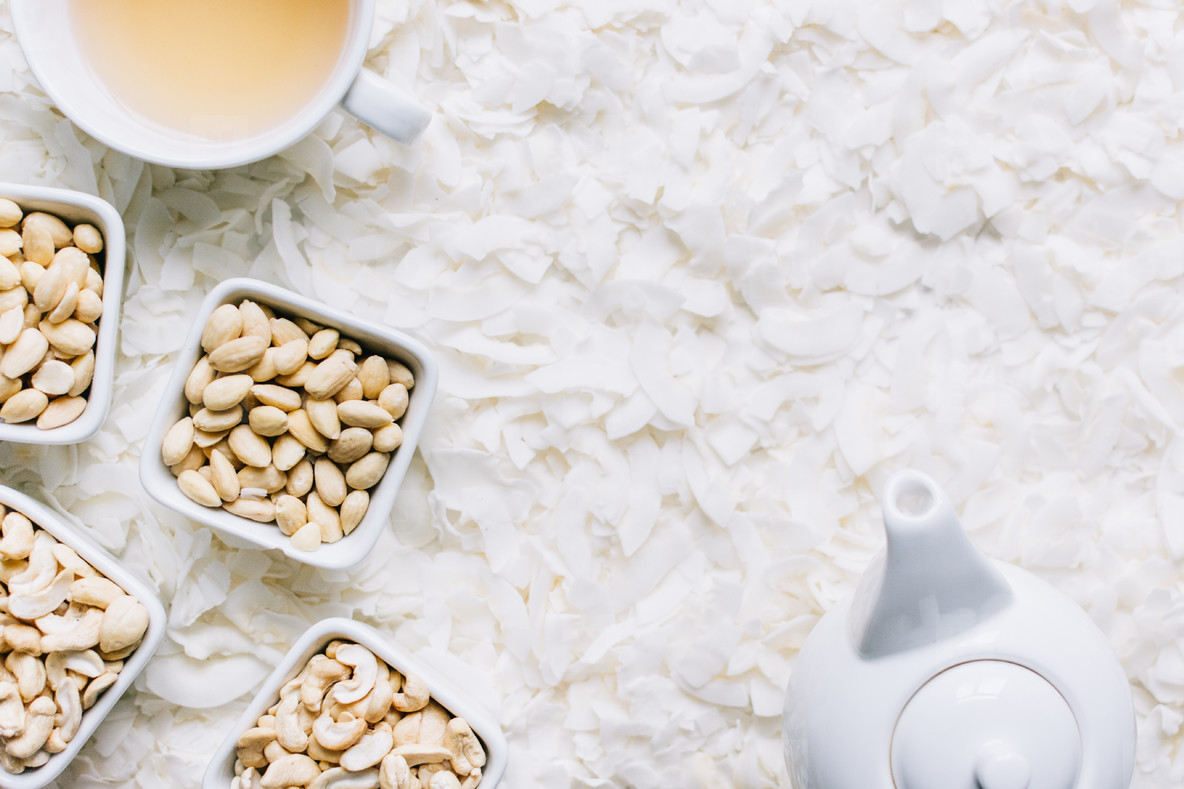 Nuts with coconut flakes and tea