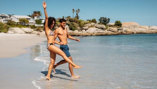 Tourist couple enjoying at the beach