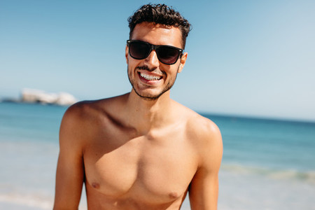 Portrait of a bare chested man at the beach