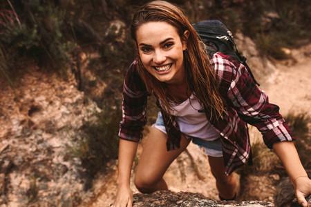 Happy backpacker hiking