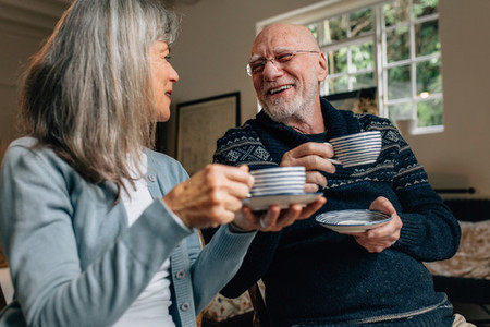 Senior couple enjoying coffee at home