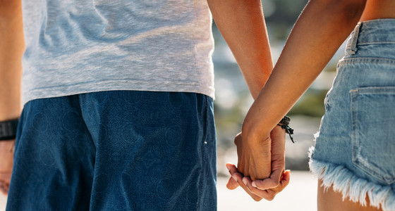 Close up of a man holding hand of a woman