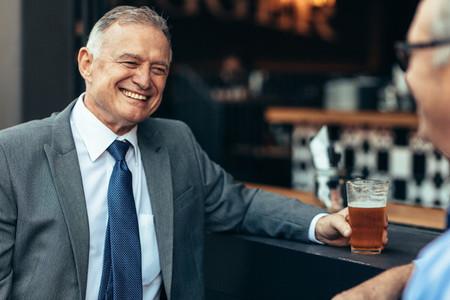 Senior business people at bar after work