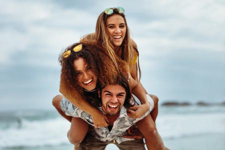 Multi ethnic friends enjoying summer holidays on beach