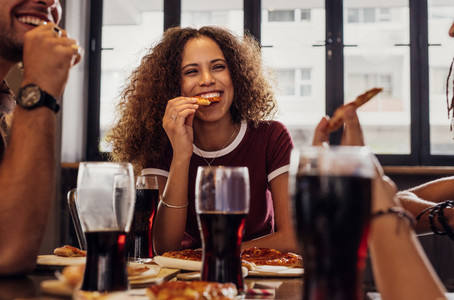 Woman with friends enjoying a meal