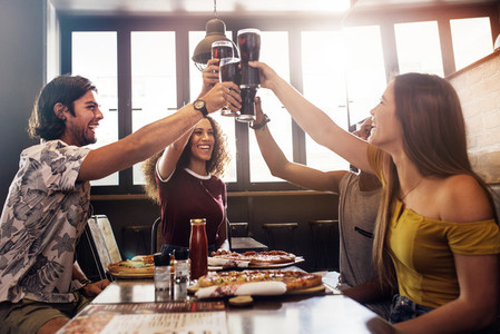 Group of friends making a toast at restaurant