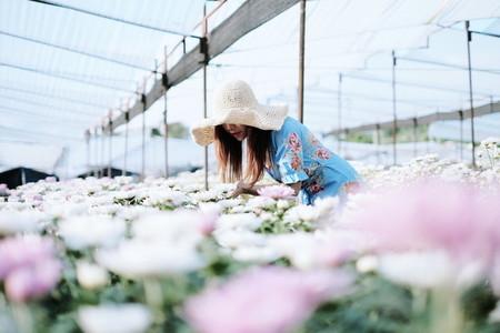 Woman enjoying flowers