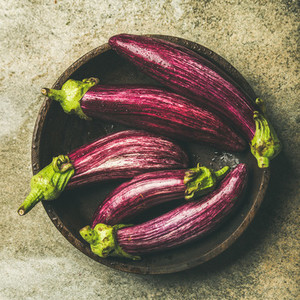 Flat lay of fresh raw Fall harvest purple eggplants  square crop
