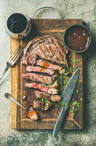 Flat lay of grilled medium rare ribeye beef steak