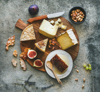 Flat lay of cheese assortment  figs  honey and nuts
