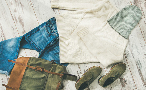 Flat lay of Fall lady s clothes outfit  horizontal composition