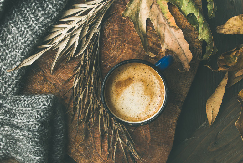 Autumn morning coffee concept with leaves and sweater  square crop