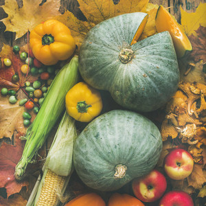 Fall vegetables assortment over wooden table background square crop