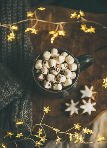 Christmas winter hot chocolate served with light garland top view