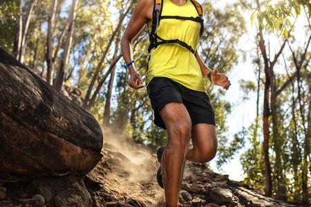 Male runner running on rocky mountian trail