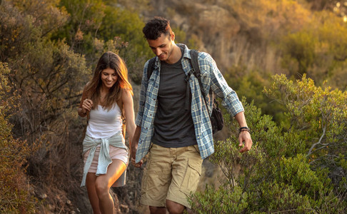 Young couple hiking together at hill side