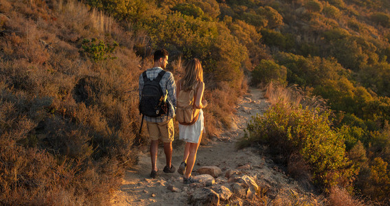 Hiker couple walking through mountain trail