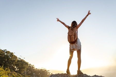 Female hiker enjoying being on top of the mountain