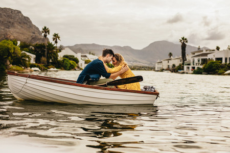 Romantic couple in love on a boat date