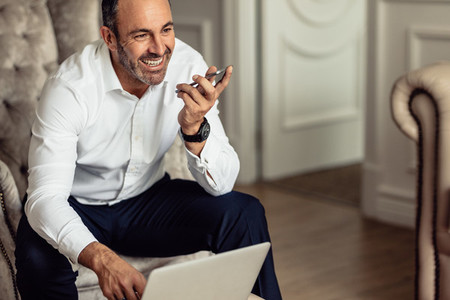 Businessman working from hotel room on business trip