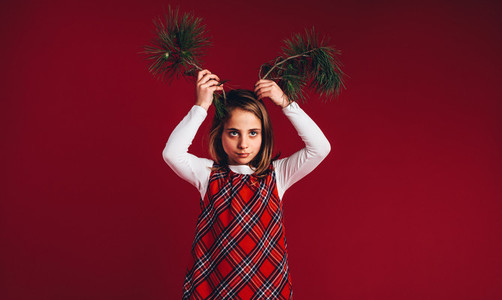 Portrait of a girl playing with twigs