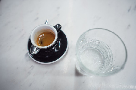 coffee mug and a glass of water on a table