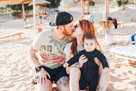 Parents spend time with their son on the beach