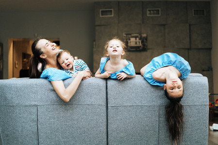 Mom  two daughters and a little son on the couch