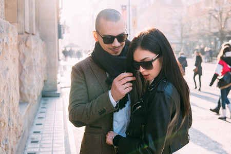 Couple walking and posing on the street