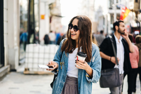 Beautiful smiling woman walking on city street