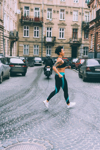Woman doing exercise in the city street