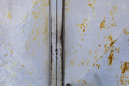 Blue rusted metal door with peeling paint