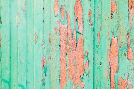 Green rusted metal door with peeling paint
