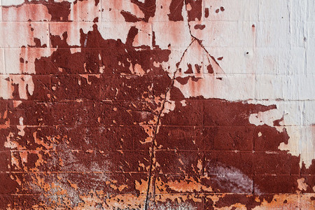Old cement wall texture background in red tones