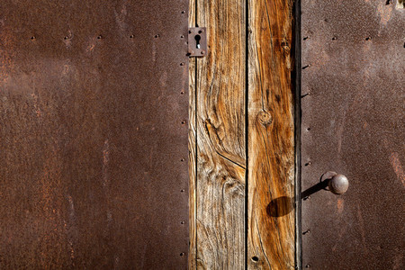 Close up brown wooden door and metallic texture with old lock