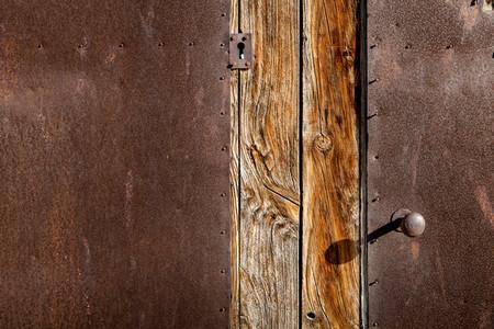 Close up brown wooden door and metallic texture with old lock