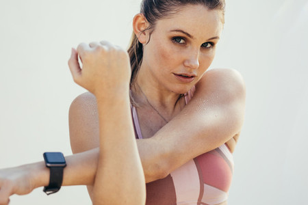 Fitness woman doing stretching exercises
