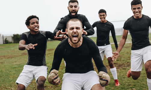 Players celebrating victory shouting in joy